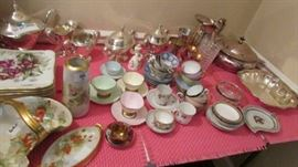 Lots of china, painted, teacups,