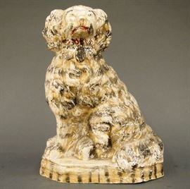 "A late 19th century chalkware dog with original polychrome decoration.  In the style of a Staffordshire dog, depicted seated on a short plinth.  Hollow cast, incised signature on the reverse appears to be ""Andrea Verzana"" with 1858.  Finish quite worn, some surface scratches.  14"" high.  ESTIMATE $200-300"