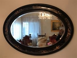Beautiful oval wall mirror with ebonized wood and Asian enameled motif