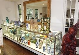 DISPLAY CASE WITH SOME OF THE ASIAN COLLECTION BEING OFFERED AT THE SALE