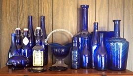 "Blue Glass Collection, Qty 17, Includes 9"" Basket, Crownford 9oz Fresh Cream Bottle, Blown Glass Twist Style Vase, Docs Tonics Bottles,Ty Nant Bottle, More"