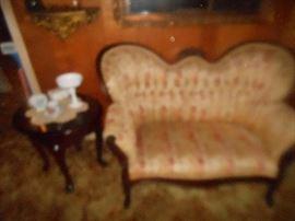 Antique tufted love seat