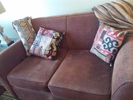 Warm Upholstered Love Seat with 4 matching pillows