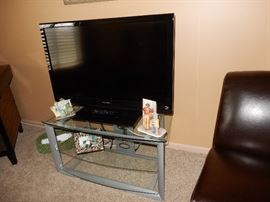 flat screen tv and stand tv by Dynex and is 42 inch screen.  The stand is 39x21x21