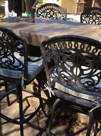 Stunning decorative wrought iron bar stools with cream/light tan Sunbrella pads