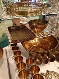 Brass trays, punch bowl, and cups