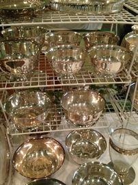 Some of the many silver plate bowls and trays