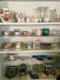 Demitasse cups & saucers and other knick knacks.