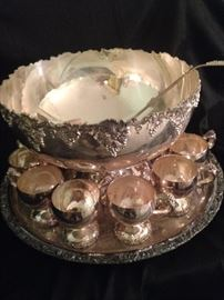 Exceptional silver plate punch bowl, ladle, tray, and matching cups