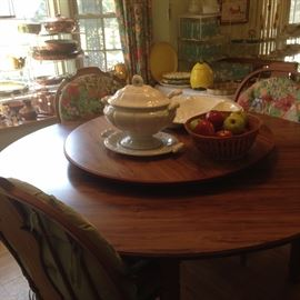 Round Lazy Susan breakfast table with 6 matching chairs; white stoneware selections