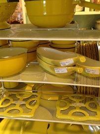 Yellow pots, pans, banana split dishes, trivets, etc