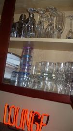 many bar glasses and other bar items