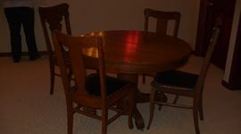 antique round oak table and 4 chairs