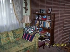 vintage wall decor, Sofa, Lamp,  Bookcase and Books,  and misc.