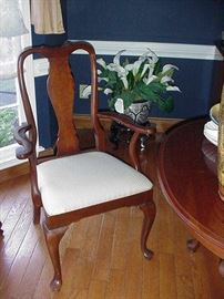 One of the Queen Anne mahogany dining chairs--2 arm chairs and four side chairs