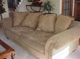Sofa with two cushions in seat and four across back