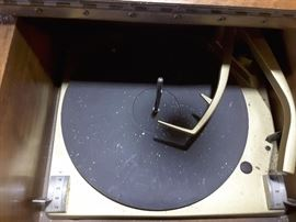 Turntable Record Player. This is built into the Piano Stereo Receiver Furniture - this is on the left side of the furniture and the lid opens up.