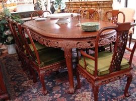 Dining set with grape design includes matching buffet. Note extra large lazy Susan in center of table and Flemish console in background.
