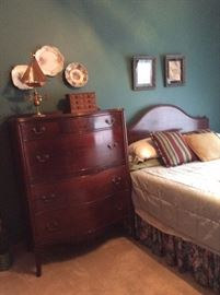 antique twin bed with bureau with art