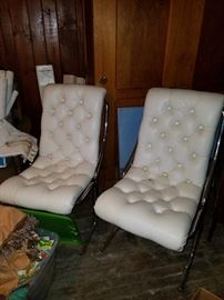 Great pair of chrome frame, white leather chairs