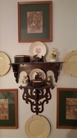 Wooden sconce, framed prints, decorative plates, and figurines