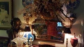 Bust, mirror, floral arrangement