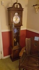 Wonderful grandfather clock and caned back wing chair