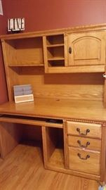 Oak desk.  3 drawers with shelved hutch.