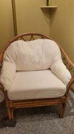 Wicker chair with white cushions