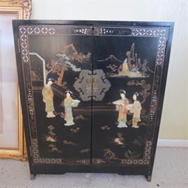 Asian style black lacquer cabinet.