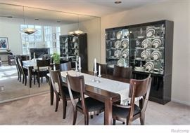 Dining Table with 6 chairs (4 side chairs & 2 captain chairs).  Table measures 82'' L (with leaf) x 40'' W x 29 1/2'' H with, leaf measures 20''.  Chair 20 1/2'' W x 20'' D x 38''H, seat height 17 1/2''.  Black Lacquered Light-up Glass Front Display Cabinet Curio by Ello Furniture.  36 1/4'' W x 17'' D x 75 1/4'' H