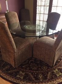 glass dining table and 6 upholstered chairs