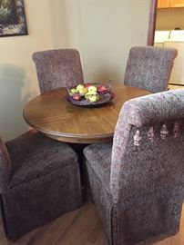 wood kitchen table and 4 upholstered chairs