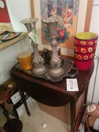 Mahogany drop-leaf table, candlesticks, glass vase, and silverplated tray