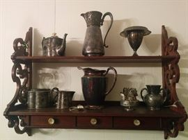 Hanging shelf and silverplated serving pieces