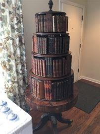 Rare multi-tiered revolving bookcase.