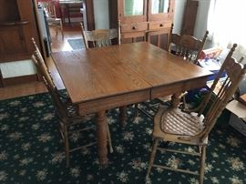 Oak table with 4 chairs.  Floral rug is also for sale