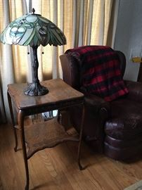 Leather arm chair, square oak side table and leaded glass shade lamp