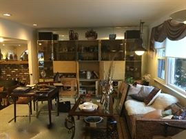 Large mirrored wall unit, sofas, coffee tables
