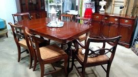 Basement Dining table and sideboard. This is a smaller version of this style set. There is a mint condition full size upstairs in the dining room