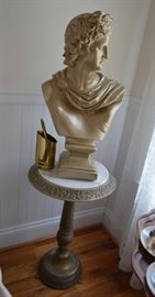 Greek God Apollo bust on marble top stand