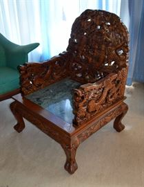 Ornate carved oriental chair with marble seat