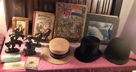 Figural book ends, a few photo postcards, vintage straw boater, old top hat, WW II M-1 metal helmet with liner, and just a few of the MANY MANY books