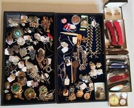 Costume jewelry including rhinestone brooches (peacock pin is SOLD), charm bracelets, dress clips, a few earrings & pocket watches. Also pocket knives.