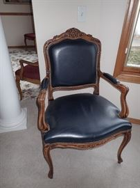 NAVY LEATHER SIDE CHAIR WITH CARVED WOOD DETAIL
