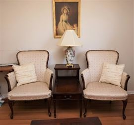 Vintage upholstered chairs and a leather top mahogany end table