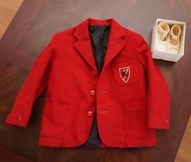 Child's sport jacket and baby shoes