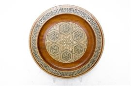 Persian Khatam Mother of Pearl and Bone Inlaid Wooden Plate: A Persian Khatam plate. This plate features an inlaid mother of pearl and bone mosaic design in wood, with hanging ring to back.