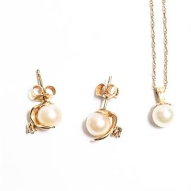 14K Yellow Gold Pearl and Diamond Necklace and Earrings Set: A 14K yellow gold pearl and diamond necklace and earrings set.