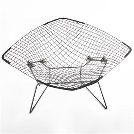 Original Harry Bertoia for Knoll International Large Diamond Chair With Cover: An original mid-century modern 422LU Bertoia Diamond chair for Knoll International with vinyl covered black wire rod seat and frame. This iconic mid-century modern design by sculptor Harry Bertoia is a fascinating study of line, form, function, and space. Chair has original full cover in woven mustard and black.